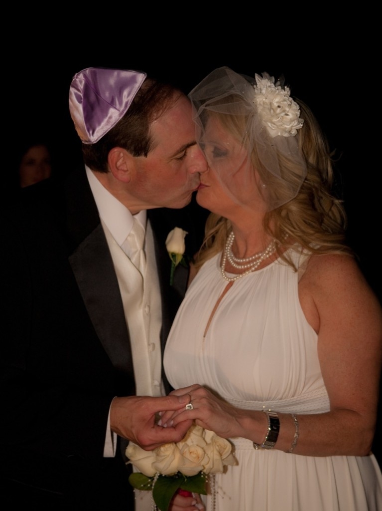 Bride and groom kissing at Jewish wedding ceremony in Atlanta