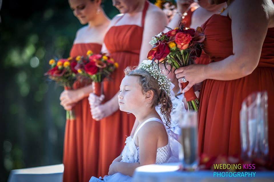 Lake Lanier Islands outdoor Wedding -- Bridesmaids and Flower Girls Praying