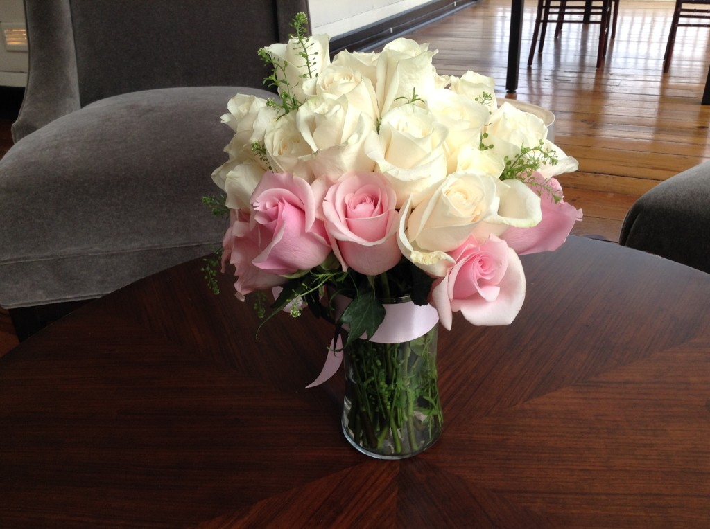 White and pink roses in vase with pink bow floral centerpiece at Atlanta wedding at 3109 Piedmont Gardens and Estate