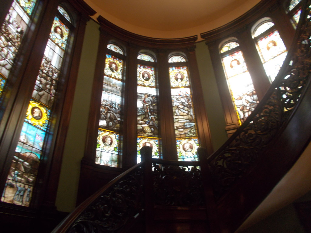 Beautiful stained glass windows around spiral staircase at Atlanta wedding venue Rhodes Hall