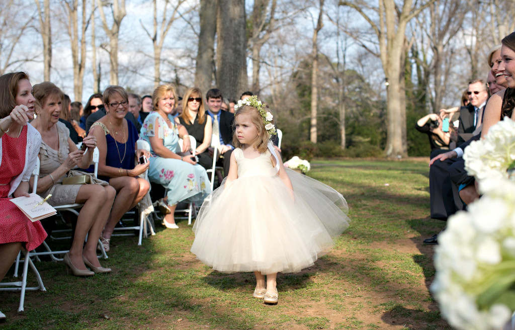 Flower girl walking down aisle at outdoor Atlanta wedding callanwolde garden fine arts center