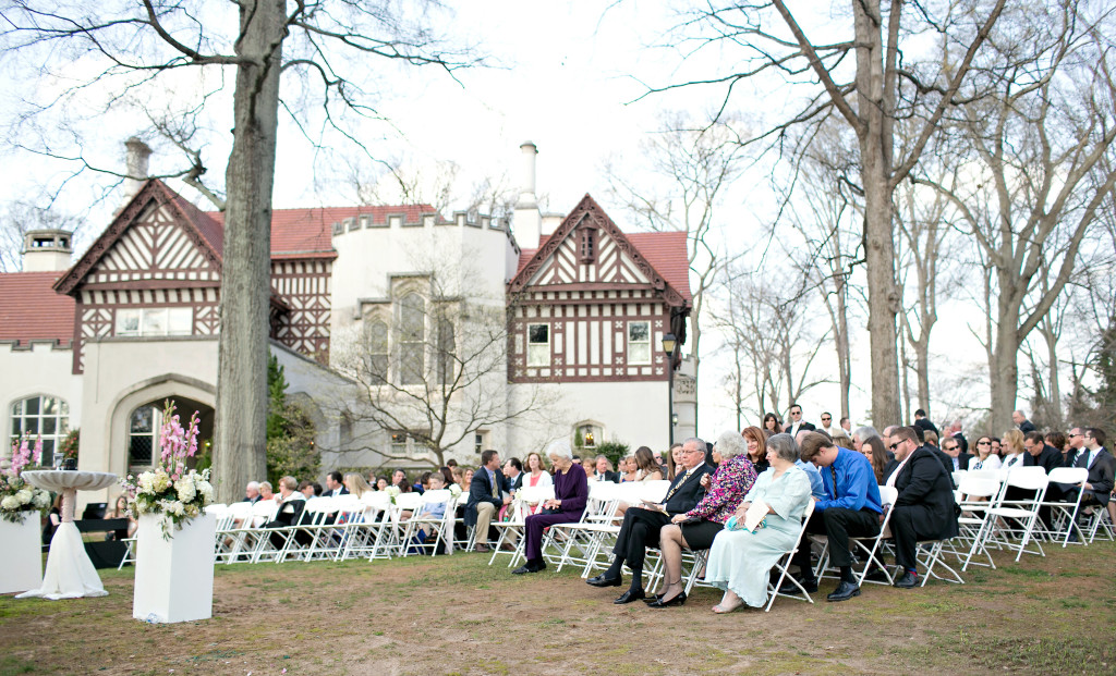 Outdoor flowers and guests in Callanwolde Gardens fine arts center wedding in Atlanta