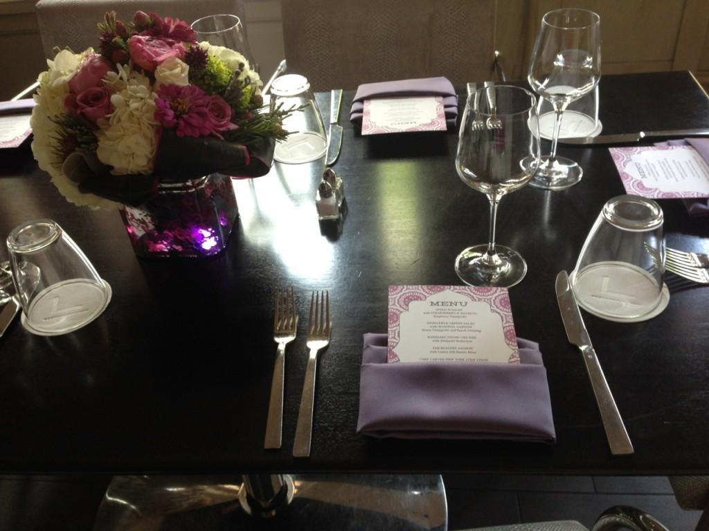 Purple place settings at wedding receptionat The Georgian Terrace Hotel
