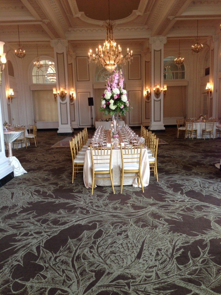 Long reception table with pink and white flowers at Atlanta wedding venue Georgian Terrace hotel