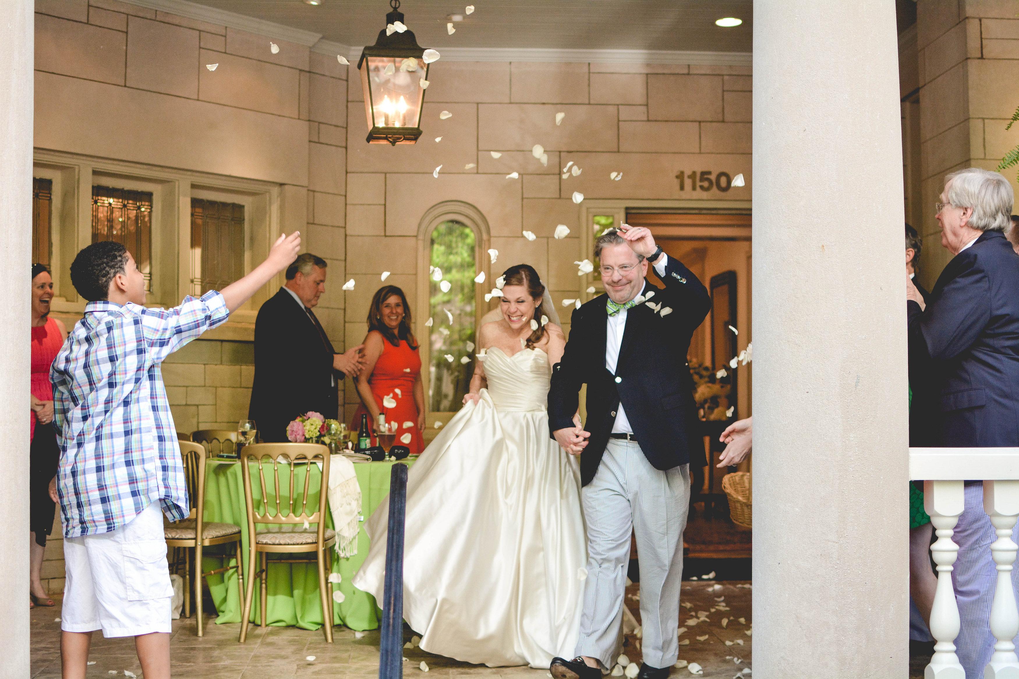 Atlanta wedding bride and groom exit with flower petals