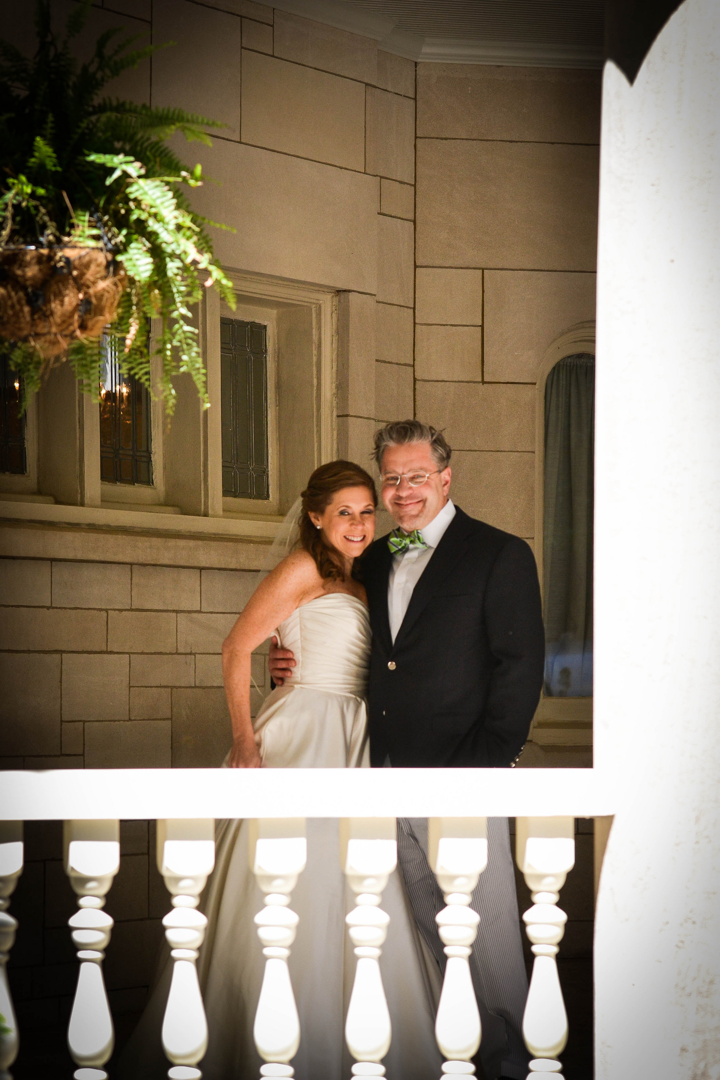 Bride and groom standing on outdoor balcony at Wimbish House on Peachtree Street