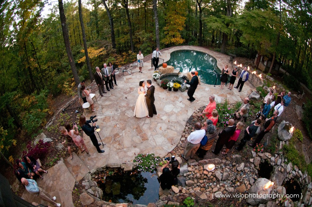 Bride and groom first dance outdoor wedding by pool in Alpharetta