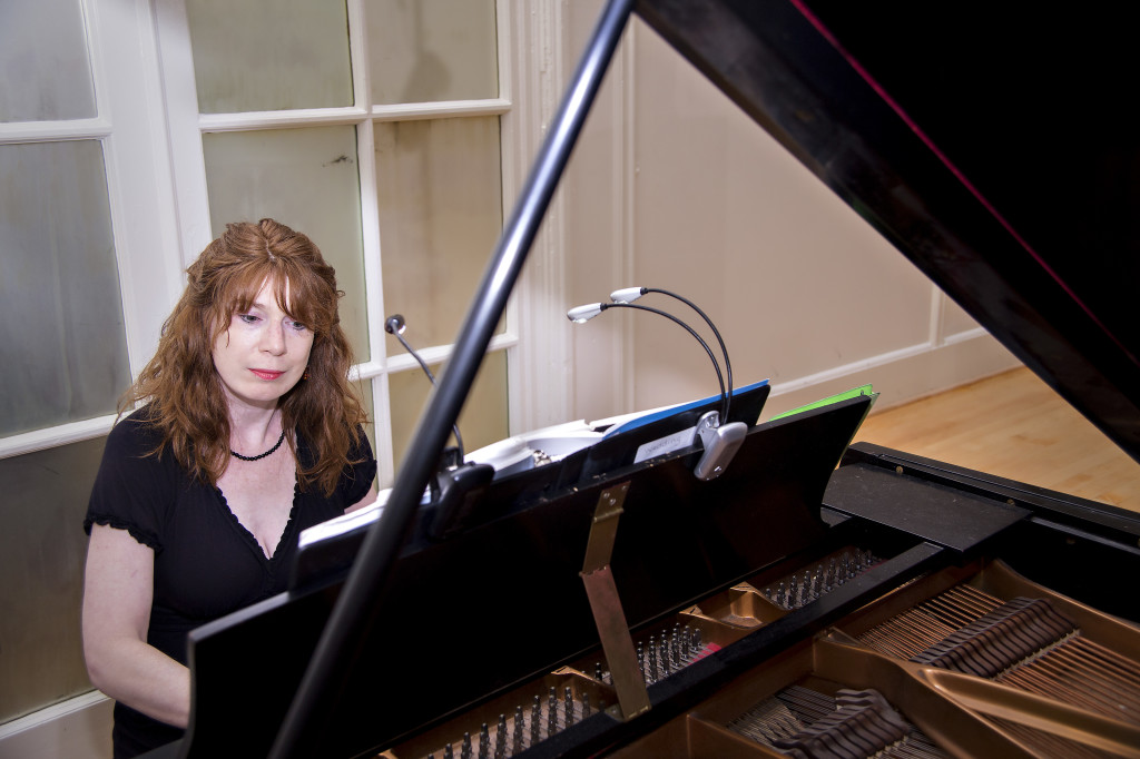 Atlanta wedding musician  Jennifer McCoy plays ceremony music at Wimbish House piano