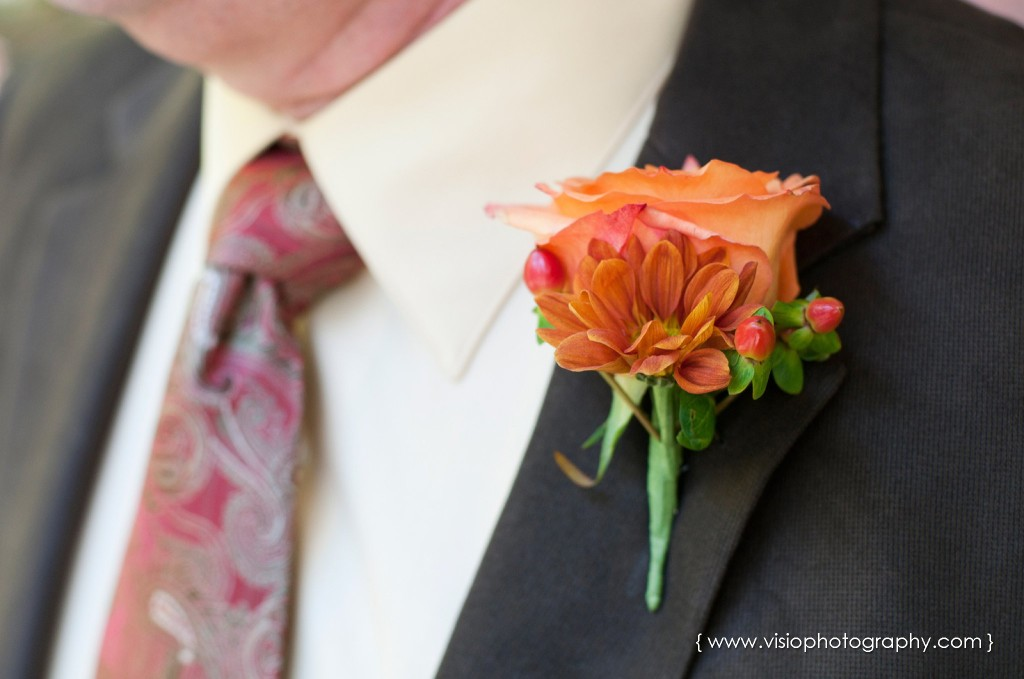 Orange boutonniere on groomsmen at fall wedding