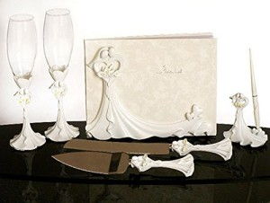 Ivory wedding guest book and pen set with cake cutter and flutes