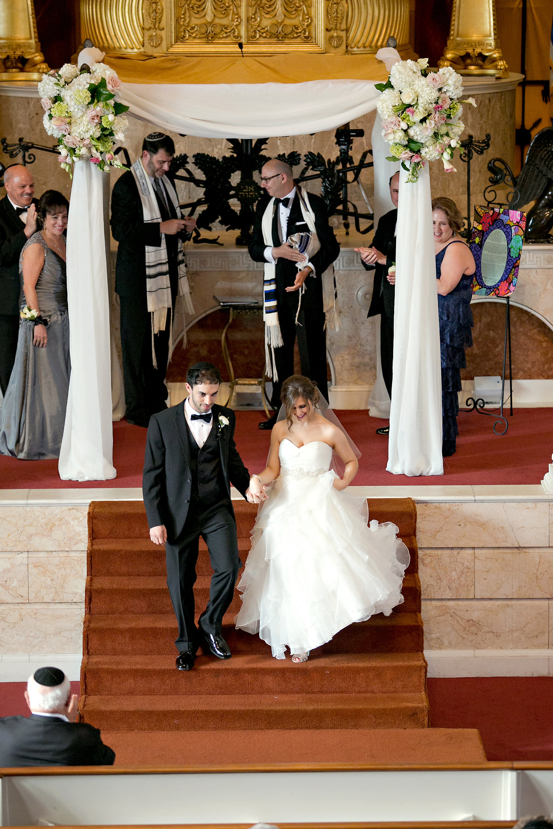 Bride and Groom exit at Jewish wedding at The Temple in midtown Atlanta
