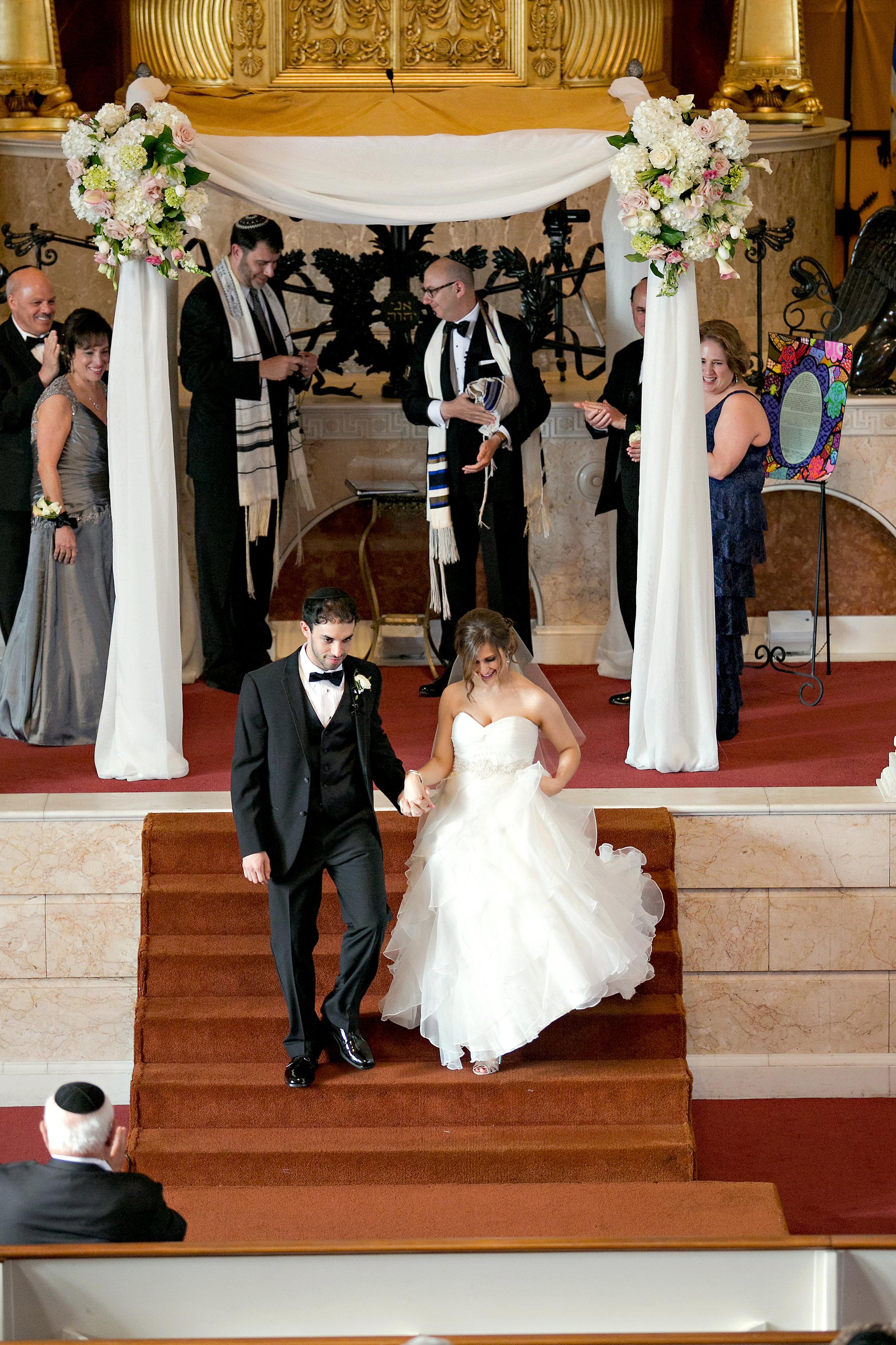 Bride and Groom exit at Jewish wedding at The Temple in midtown Atlanta