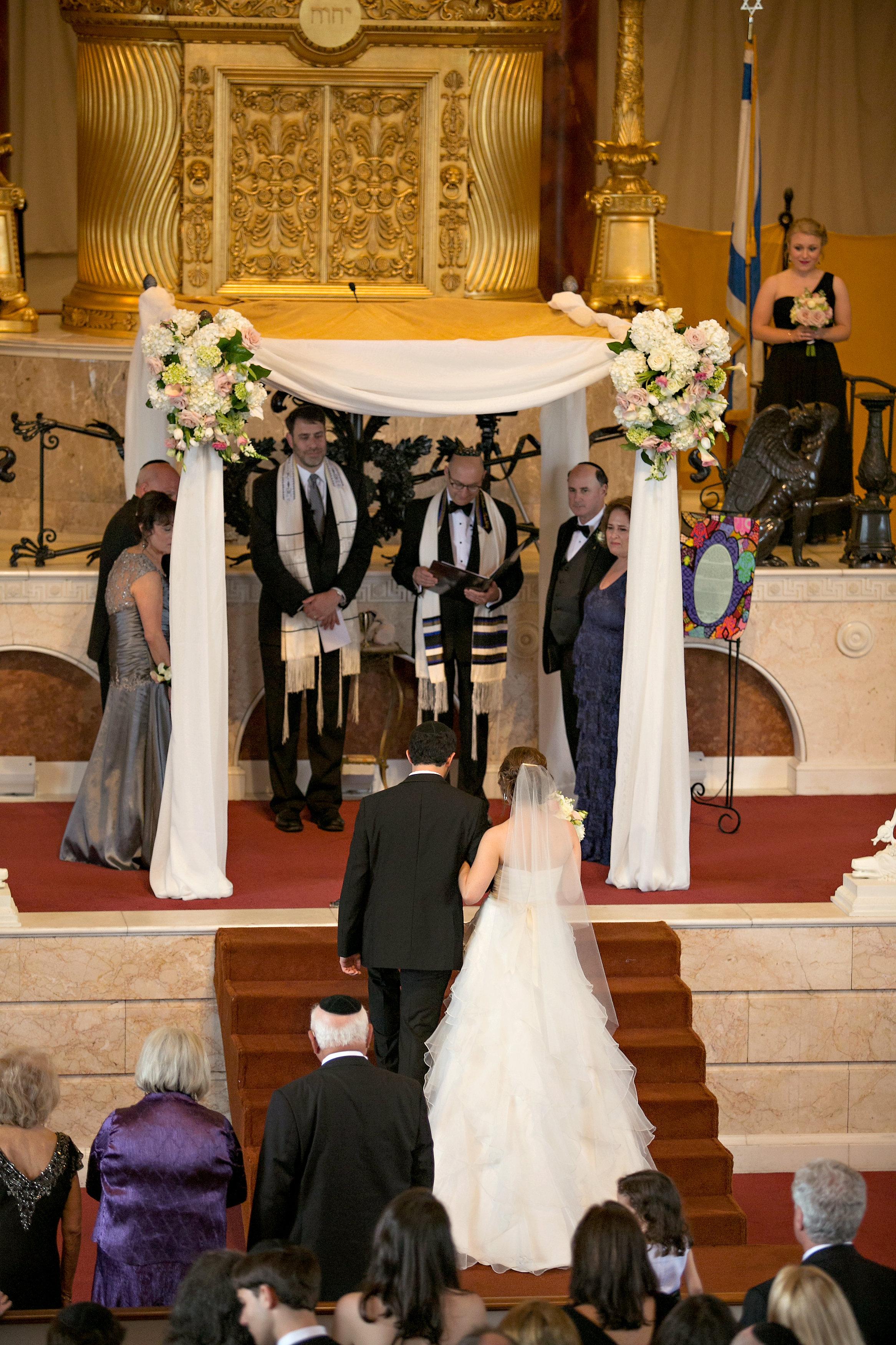 Bridal Entrance at Jewish wedding at The Temple in midtown Atlanta with traditional Jewish chuppah