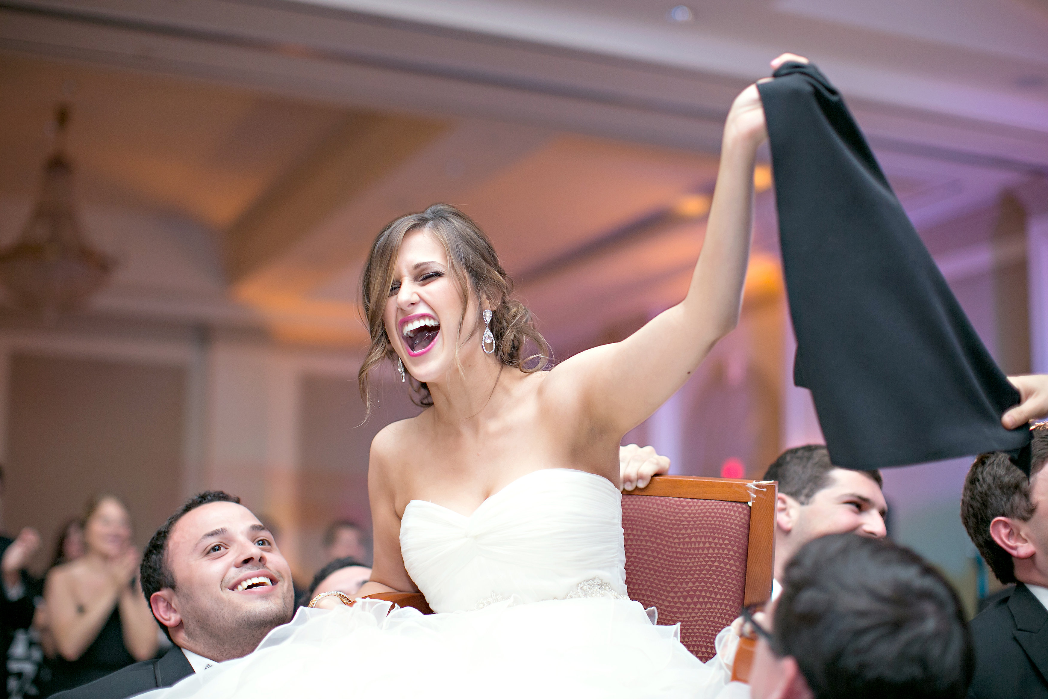 Bride at traditional Hora Chair Dance at Jewish wedding The Temple Atlanta