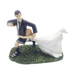 Rugby wedding cake topper with bride and groom