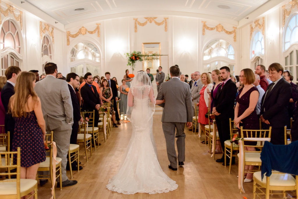 Bride coming down the aisle at Wimbish House wedding ceremony