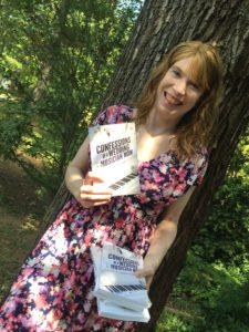 jenny-against-tree-holding-paperback-book