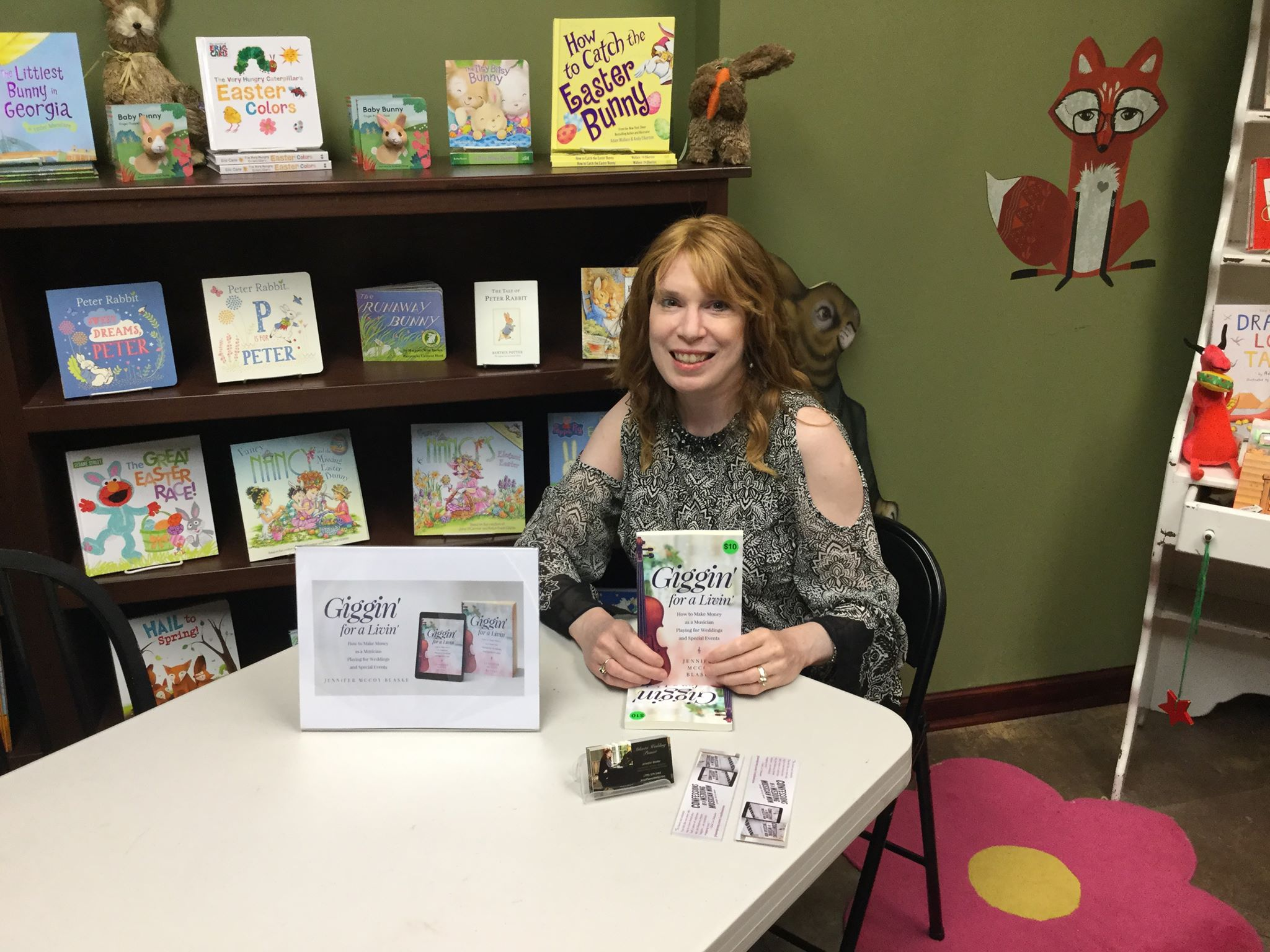 Signing books at Emerging Author Night at FoxTale Book Shoppee